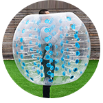 Tall man placed into a bubble zorb ball at London Park