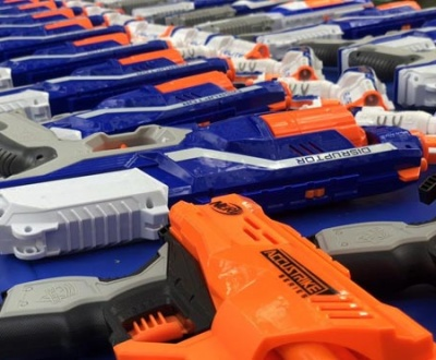 wide range of nerf guns on a blue table